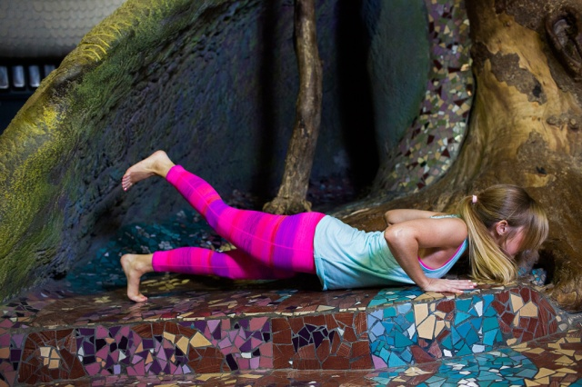 Sets and Sequins Blog: yoga enchantment styled by Sarah Bourne - printed pink purple striped tie dye leggings with racerback blue tank hot pink sports bra at the city museum in st. louis missouri from chicago illinois photography by erin stubblefield beginner yoga poses fitness fashion style sweat beauty bravery strong and stretchy
